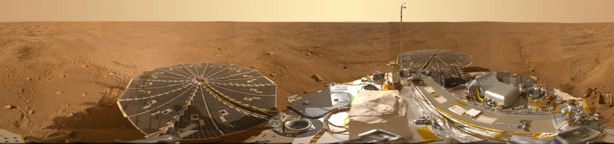 wide angle view of mars with lander in the foreground